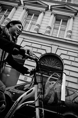 _DSC4353 (stimpsonjake) Tags: nikoncoolpixa 185mm streetphotography bucharest romania city candid blackandwhite bw monochrome happy bicycle girl youngwoman smile