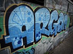 ARGON - Graffiti Bristol (Oliver_Parton) Tags: street portrait white black rooftop up wall writing bristol stencil sticker exposure paint mask top tag can spray pigs piece argon cheltenham throwup writtenword