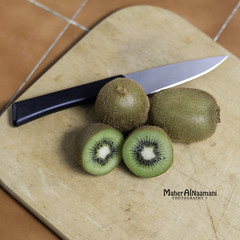 Kiwi Fruit (mahernaamani) Tags: wood fruit canon wow table photography photographer knife hungry kiwi oman muscat kiwifruit foodphotography  omani          canon6d