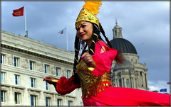 Oriental (* RICHARD M (Over 5.5 million views)) Tags: street fashion liverpool portraits happy candid smiles happiness flags portraiture dome bling pigtails oriental fashionshow eastern catwalk pierhead trinkets merseyside streetportraits fashionparade capitalofculture streetportraiture fareastern candidportraits europeancapitalofculture candidportraiture maritimemercantilecity onemagnificentcity theverybigcatwalk