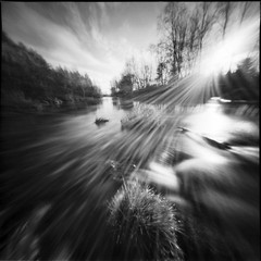 play with sunbeams (Foide) Tags: sky water clouds pinhole nordic sunbeams nolens malax f137 malaxriver