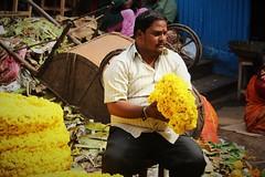 Bundling up (bluelotus92) Tags: india flower market sale flowervendor karnataka mysore flowerseller mysuru bundleofflowers devarajursmarket devarajaursmarket flowerwinding