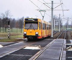 Once upon a time - The Netherlands - Utrecht Westraven (railasia) Tags: holland provinceutrecht utrecht westraven sun articulatedmotorcar sig deliverydesign infra levelcrossing eighties