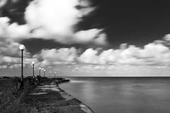 (Jordi Cucurull) Tags: sea mar longexposure largaexposicin llargaexposici filters filtros filtres farolas faroles streetlights rompeolas escullera trencaones breakwater 6d 2470 haida lee nubes nvols clouds bn bw