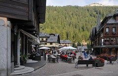Madonna di Campiglio backdrop (Vee living life to the full) Tags: madonnadicampilio skiresort mountains shopping tourists nikond300 italy trentino hotels park trees flowers cafes pavement outside forests aboriculture