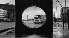 architectural postcard of Malmo seaside (lunaryuna) Tags: sweden southsweden skane malmo urban seasidetown buildings architecture frame sculpture coast boats ships lighthouse urbanconstructs walkinthecity urbanlandscape blackwhite bw monohrome weathermisery lunaryuna