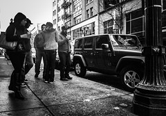 Admiring The Ride (TMimages PDX) Tags: road street city autumn people urban blackandwhite monochrome buildings portland geotagged photography photo image streetphotography streetscene sidewalk photograph pedestrians pacificnorthwest avenue vignette fineartphotography iphoneography