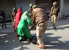 Indian policemen thrash a local  youth in Maisuma area of Srinagar,Indian controlled Kashmir (Umer Asif.) Tags: kashmiri muslim women shout anti india slogans youth