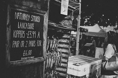 Kippers (MMortAH) Tags: 14 30mm bw black d90 fall nikon sigma york yorkshire autumn drink festival food kippers market monochrome people produce stalls street white yorkfood