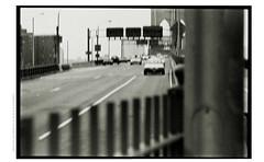 bbshotNYCHP5000expo (Ilia Farniev) Tags: brooklynbridge slide ilford rodinal contax tessar hp5 traffic marginal merrill   ghost seemmingly fence anotherside  stranger drift unpeuleuche cloudyweather glitch swag microphone zasada pedestrean stride flux