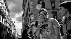 Eyes on you. (Baz 120) Tags: candid candidstreet candidportrait city candidface candidphotography contrast street streetphoto streetcandid streetphotography streetphotograph streetportrait streetfaces rome roma romepeople romecandid romestreets monochrome monotone mono blackandwhite bw urban noiretblanc voigtlandercolorskopar21mmf40 life leicam8 leica primelens portrait people unposed italy italia girl grittystreetphotography flashstreetphotography faces flash decisivemoment strangers