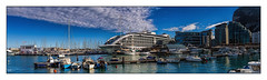 Sunborn Gibraltar (Kevin, from Manchester) Tags: architecture canon1855mm english gibraltar kevinwalker panoramic photoborder sunborn hotel harbour spain sea sky clouds boats