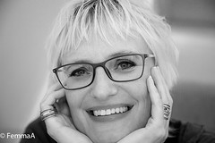 (femmaryann) Tags: blackandwhite smile woman blonde glasses indoors portrait natural dof dimples dents beauty warmth soul