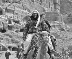 Petra taxi with anxious passenger (GrinningCatPhotos) Tags: travel blackandwhite bw tourism monochrome taxi petra streetphotography jordan camel