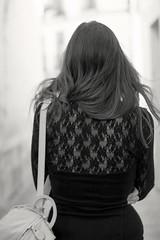 Paseando (evamlidn) Tags: street people bw woman white black cold blanco girl hair bag person persona calle back mujer gente wind lace walk negro viento paseo step torso hip curve fro bolso pelo misterious pasos curva cadera detrs encaje misteriosa esplada