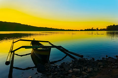 dramatic sunrise (sydeen) Tags: morning blue sunset sea summer sky bali orange lake reflection tourism nature water beautiful silhouette sport yellow sunrise indonesia landscape boat pond dusk traditional horizon romantic tamblingan