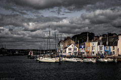 Colours against the grey (Anthony Plancherel) Tags: houses sea england water clouds river boats grey coast boat town seaside fishing waves colours harbour terrace transport places quay estuary hills coastal dorset coastline mast colourful weymouth trawler greysky quayside riverwey greyclouds fishingport yatchs terracedhouses
