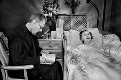 Last Rites (sophie_merlo) Tags: old blackandwhite bw church monochrome dark death catholic religion photojournalism documentary elderly dying grief photodocumentary zwatwit