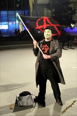Anti-Trump Protester (PhotoJester40) Tags: amdphotographer male protester flag mask guyfawkesmask anarchist outdoors outside nighttime posing