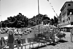 """Faces"" (giannipaoloziliani) Tags: faces view blackandwhite allaperto people tourists portofino liguria italy italia sea mare beach spiaggia landscape nikoncamera panorama persona nikond3200 nikon perspective country boats water sunlight light shadows sole sun"