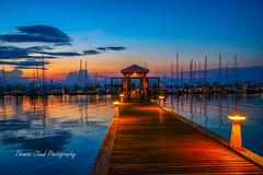 Marina Sunrise (tclaud2002) Tags: marina boats sailboats mast masts sun sunrise sky horizon water river stlicieriver stuart florida usa clouds light