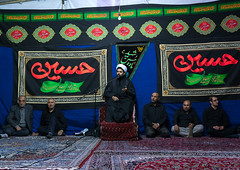 Iranian shiite muslim men listening to a mullah who preaches during muharram, Central county, Theran, Iran (Eric Lafforgue) Tags: 9people adultsonly ashura calligraphy ceremony colorimage commemorate faith horizontal hosseinieh hussain imamhussein indoors iran iranian iranianculture islam menonly middleeast mourning muharram muslim people persia pray prayer praying religion remembrance ritual script shia shiism shiite spirituality tehran tradition worship worshiping theran centralcounty