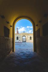 Passage (Nicola Pezzoli) Tags: favignana sicilia sicily island egadi summer sea water colors nature canon tourism passage blue sky clouds tonnara stabilimento florio chimney