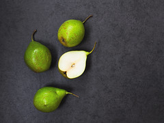 Four  pears on gray background (Olga_Z1982) Tags: pear half four organic fruit sweet ripe grey gray background stilllife section autmn shot seed color object part single season raw cut green stone