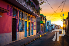 Street in Camaguey (julianpetersphotography) Tags: america architectural building camaguey caribbean city cityscape colorful communism cuba cuban culture destination exterior heritage historic house houses latin latinamerica old place red scene sightseeing socialism street structure tourism town traditional travel unesco urban view vintage world yellow