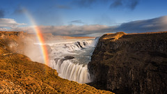 Bring me sunshine (Pete Rowbottom, Wigan, UK) Tags: gullfoss iceland icelandic waterfalls water falls goldenlight goldencircle southerniceland southwesticeland hvtriver landscape waterscape rainbow rainbows dramatic beautiful amazing peterowbottom cliffs warmth blueskies travel vacation rocky outdoor icelandlandscape nikond750 colourful vivid vast remote scenic europe goldenhour sunlight scandinavian traveldestination waterrainbow waterfallrainbow
