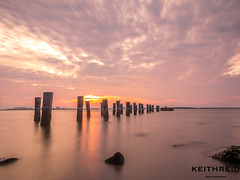 Sunset 39/52 (Keith Reid Photography) Tags: sunset pillars landscape lake ocean water clouds longexposure 52 52weeksofphotography 52week 52weekproject waterfront waterscape lights shadows