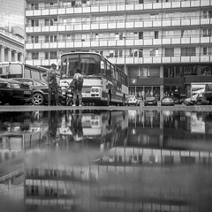 Warsaw, Poland. (wojszyca) Tags: yashica mat 124g tlr 6x6 120 mediumformat kodak trix 400tx 400 hc110 163 h gossen lunaprosbc epson 4990 city urban puddle reflection parking lot street socialist modernism bus warsaw warszawa