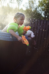 Water! (Dalla*) Tags: boy orange playing hot color green water outside iceland droplets kid cabin child play action tub guns splash wwwdallais