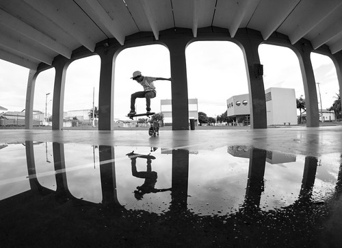 Ravi ollie reflecting on the water B&W
