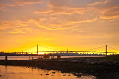 Sunset on a Cloud Covered Day (Lojones13) Tags: sunset newyork cloudy horizon eastriver magichour whitestonebridge