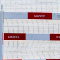 Seasonal colours (zeh.hah.es.) Tags: red white rot fence grid grey schweiz switzerland construction zurich gray grau zrich constructionsite weiss gitter kreis5 hardbrcke bauzaun maagareal