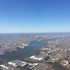 Philadelphia (Molly Des Jardin) Tags: new city bridge blue sky usa philadelphia skyline plane river airplane flying newjersey highway industrial pennsylvania south horizon jersey delaware expressway overhead delawareriver southphilly 2015 iphone5sbackcamera415mmf22