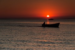 At the day's end (Anthony Plancherel) Tags: boat erdek places seascape sunset transport travel turkey evening orange sky sun cloud silhouette boats motor canon1585mm canon70d canon sea headland coast coastal coastline seaside travelphotography landscapephotography waves rippled reflections reflectedlight wow outdoor vehicle