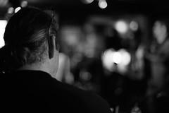 Man with ponytail (stefankamert) Tags: stefankamert ponytail man dof blur blurred blury bw sw baw noir noiretblanc monochrome mono blackandwhite blackwhite sony a7 ilce7 fullframe mirrorless minolta mdrokkor rokkor md black lights lowlight