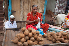 Frowning woman (Scalino) Tags: india karnataka travel trip badami durga temple fromtherickshaw streetphotography street surprise unposed onspot passingby market frowning mefiant woman red sari coconut seller