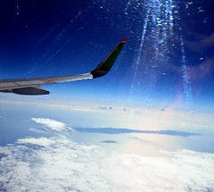 above the ocean (oneroadlucky) Tags: nature sky ocean sunray see airplane