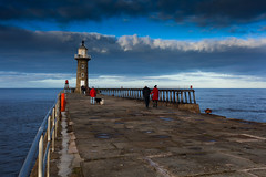 Strolling (_MG_7346) (depthoffield) Tags: whitby harbour wall lighthouse pier people sea sky