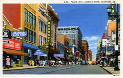 Fourth Avenue Looking North Louisville KY (Edge and corner wear) Tags: vintage postcard pc main street downtown kentucky read more card shop neon sign storefront magazines souvenirs burdorf rugs furniture store cake box movie cinema theatre marquee films rialto singer blue bear cafeteria 7up