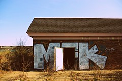 Abandoned Motel Urban Exploration Entrance (Abandoned Illinois) Tags: abandoned illinois urbex urbexing urban exploration door sky horizon graffiti spray paint open welcoming cloudless hotel bricks wall building concrete cement art photography