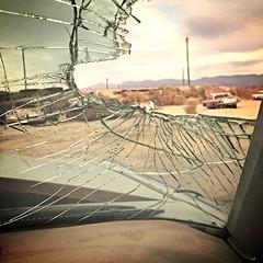 broken views (Maureen Bond) Tags: desert ca maureenbond warm car automobile classic vintage broken glass shattered spider mountains quiet clouds cracked iphone