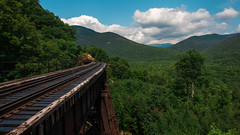 Mountain Man Expressway (Scotty G Photography) Tags: new trees summer england sky cliff mountain mountains color tree nature beautiful pine clouds forest train canon landscape fun happy crazy high amazing cool scenery colorful picnic track afternoon view sweet hiking unique gorgeous hill dream scenic tracks style happiness august hampshire hike hills professional trail frankenstein express expressway exquisite elevation bliss sept1 70d