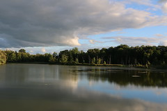 Storm passing the lake    (Explored-8-29-15-Thank you.) (outdoorpict) Tags: blue trees sky lake reflection water sunshine clouds dark evening still quiet shadows calm shrubs windless
