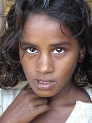 Young refugee girl near heavily damaged Arugam Bay, Sri Lanka