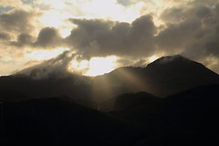 Sunset over Snowdon (Matthew Douglass) Tags: sunset cloud sun mountain black mountains broken nature silhouette yellow set wales fauna clouds canon landscape eos evening landscapes ray mt natural cloudy bokeh dusk hill silhouettes sunny aerial hills scatter 7d snowdon layer layers rays welsh snowdonia setting silhouetted