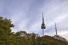 Seoul Tower in Autumn (Johnnie Shene Photography(Thanks, 1Million+ Views)) Tags: trip travel autumn people mountain colour macro building tower nature horizontal architecture clouds trekking canon lens photography eos rebel dc focus scenery kiss long exterior place natural image outdoor hiking no famous sightseeing scenic n sigma landmark artificial korea spot structure climbing korean seoul destination tall popular distance 1770 cloudscape built attraction symbolic freshness foreground selective t3i x5 namsan fragility 284 600d 1770mm f284